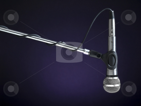 Radio mic stock photo, A microphone on a boom over a blue background. by Ignacio Gonzalez Prado