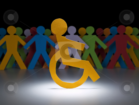 Disabled paper figure stock photo, A disable paper figure stands under the spotlight on his wheelchair. by Ignacio Gonzalez Prado