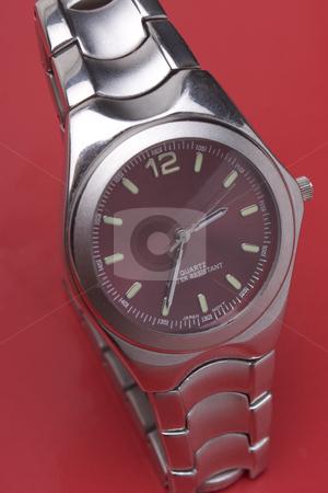 Men sport watch stock photo, Men sport watch on red background by Yann Poirier