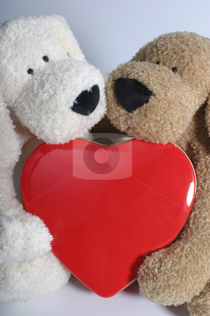 Puppy hug heart stock photo, Two stuff puppy hugging a metal heart by Yann Poirier