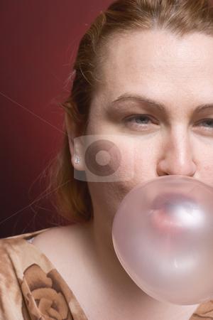 Women bubble gum stock photo, Women blowing a big bubble gum by Yann Poirier