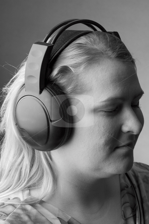 Women listing to music stock photo, Profile of women listing to music by Yann Poirier
