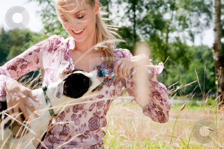 Playing with the toy stock photo, Blond girl and a american bulldog in the park by Frenk and Danielle Kaufmann
