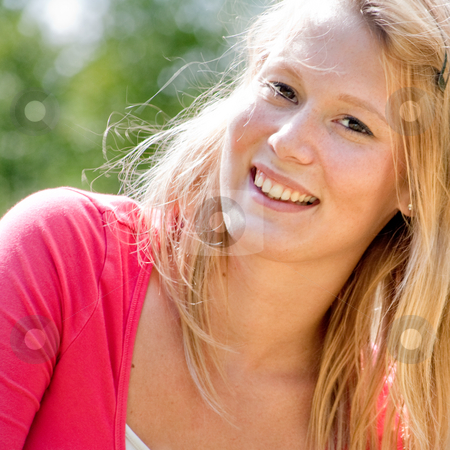 Young blond smiling woman outside stock photo, A blond woman in the park with sunny weather by Frenk and Danielle Kaufmann