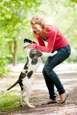 Cute girl and dog stock photo, Blond girl and a american bulldog in the park by Frenk and Danielle Kaufmann