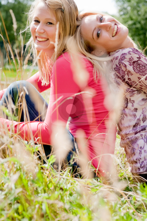 Lifestyle sisters stock photo, Two sisters in the park enjoying the good weather by Frenk and Danielle Kaufmann