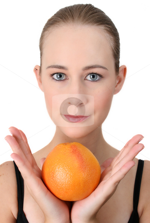 Healthy Lifestyle stock photo, Beautiful young model holding an orange in her hands by Vanessa Van Rensburg