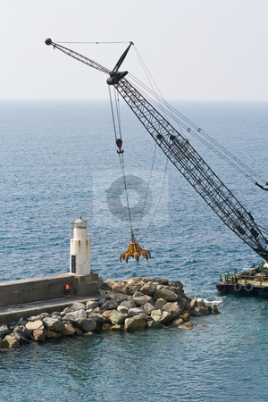 Crane stock photo, Construction barge ready to install piers for a new dock by ANTONIO SCARPI