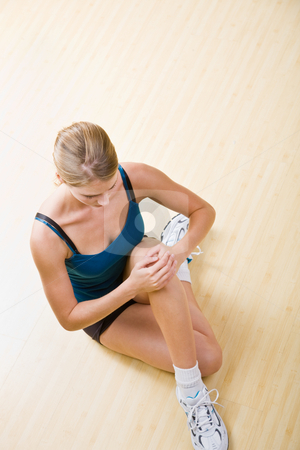 Woman stretching in health club stock photo, Woman stretching in health club by Jonathan Ross