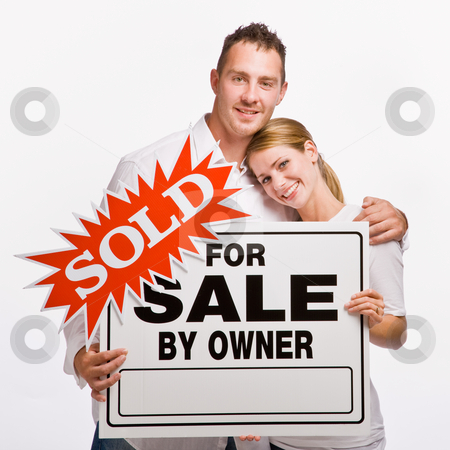 Couple holding for sale sign stock photo, Couple holding for sale sign by Jonathan Ross