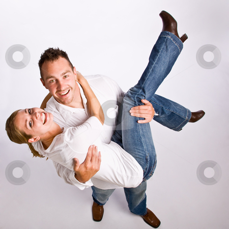 Boyfriend carrying girlfriend stock photo, Boyfriend carrying girlfriend by Jonathan Ross