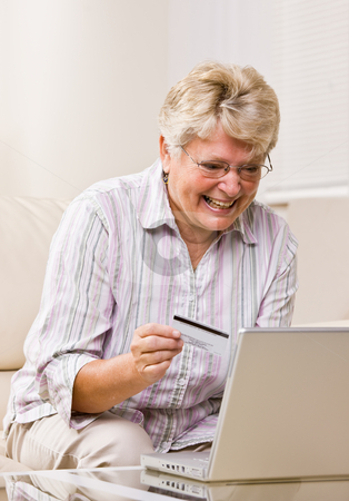 Senior woman using creditcard to buy internet merchandise stock photo, Woman using creditcard to buy internet merchandise by Jonathan Ross