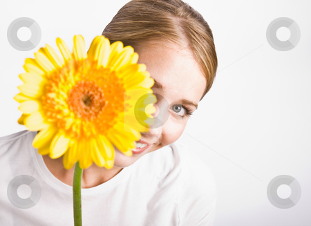Woman holding flower stock photo, Woman holding flower by Jonathan Ross
