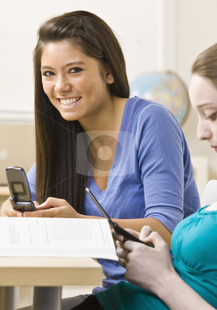 Students text messaging on cell phones stock photo, Students text messaging on cell phones by Jonathan Ross