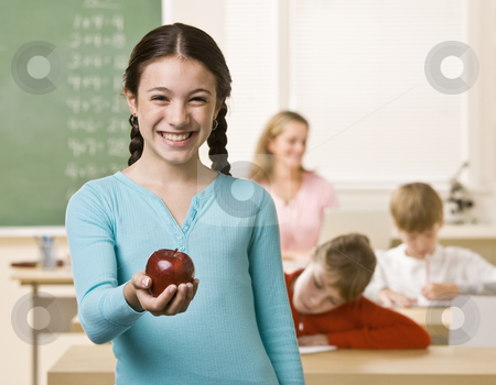 Student holding apple stock photo, Student holding apple by Jonathan Ross