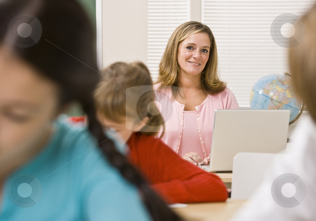 Teacher and students in classroom stock photo, Teacher and students in classroom by Jonathan Ross