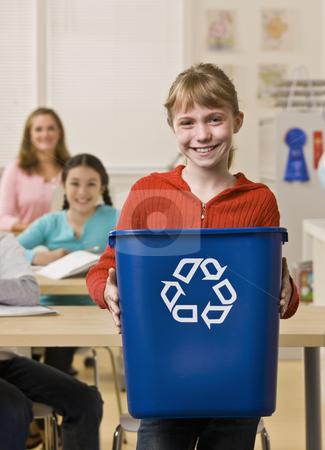 Girl holding recycling bin stock photo, Girl holding recycling bin by Jonathan Ross