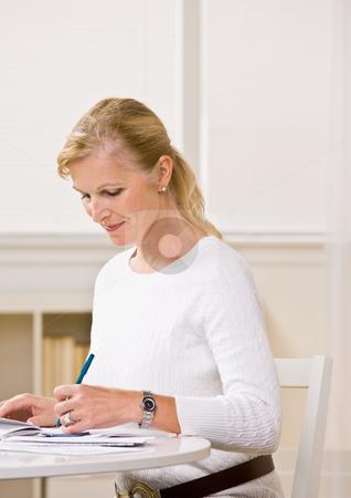 Woman writing checks stock photo, Woman writing checks by Jonathan Ross