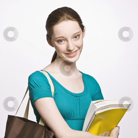Student carrying book bag and notebook stock photo, Student carrying book bag and notebook by Jonathan Ross