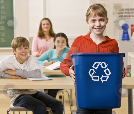 Student carrying recycling bin stock photo, Student carrying recycling bin by Jonathan Ross