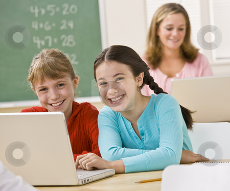 Girls using laptop in classroom stock photo, Girls using laptop in classroom by Jonathan Ross