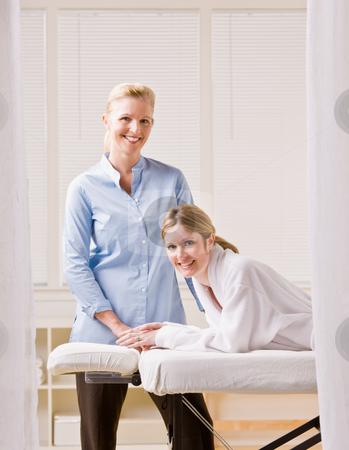 Woman and massage therapist stock photo, Woman and massage therapist by Jonathan Ross
