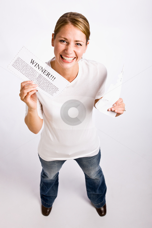 Woman holding ?winner? notification stock photo, Woman holding ?winner? notification by Jonathan Ross