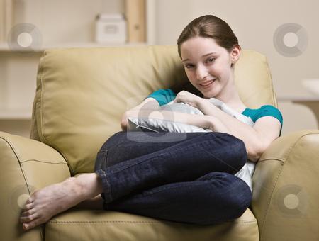 Teenage girl sitting in chair stock photo, Teenage girl sitting in chair by Jonathan Ross