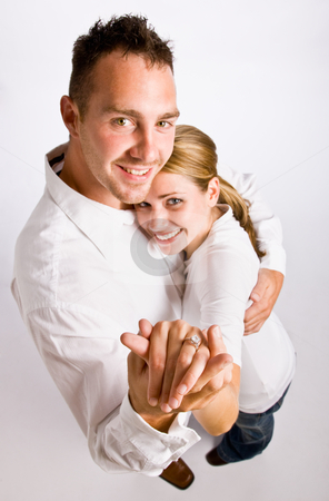Couple hugging and displaying engagement ring stock photo, Couple hugging and displaying engagement ring by Jonathan Ross