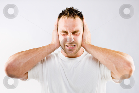 Man blocking out loud noise from ears stock photo, Man blocking out loud noise from ears by Jonathan Ross