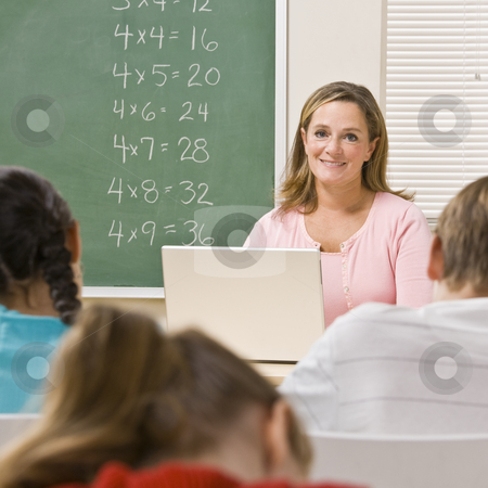 Teacher with laptop in classroom stock photo, Teacher with laptop in classroom by Jonathan Ross