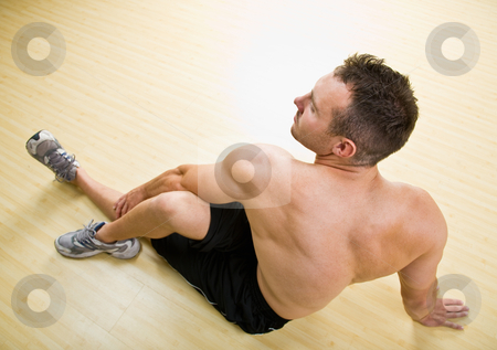 Man stretching in health club stock photo, Man stretching in health club by Jonathan Ross