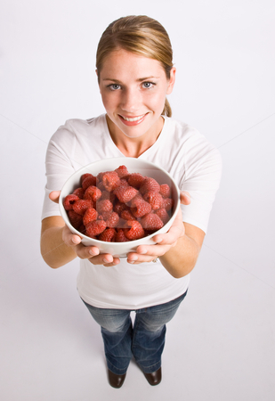 Woman holding bowl of raspberries stock photo, Woman holding bowl of raspberries by Jonathan Ross