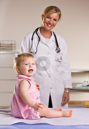 Doctor and baby girl in doctor?s office stock photo, Doctor and baby girl in doctor?s office by Jonathan Ross