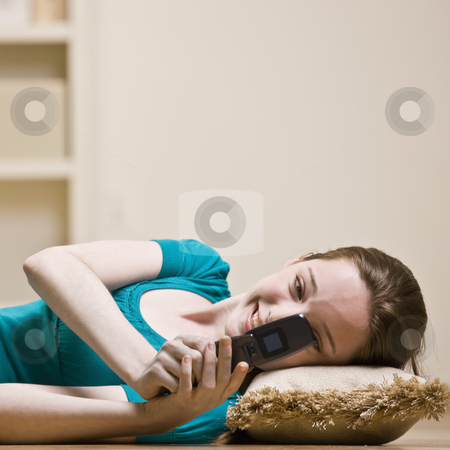 Teenage girl text messaging on cell phone stock photo, Teenage girl text messaging on cell phone by Jonathan Ross