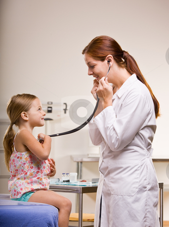 Doctor giving girl checkup in doctor?s office stock photo, Doctor giving girl checkup in doctor?s office by Jonathan Ross