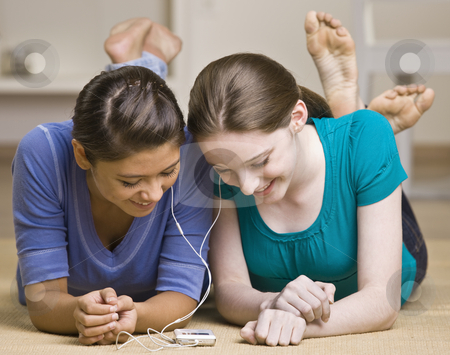 Teenage girls sharing mp3 player stock photo, Teenage girls sharing mp3 player by Jonathan Ross