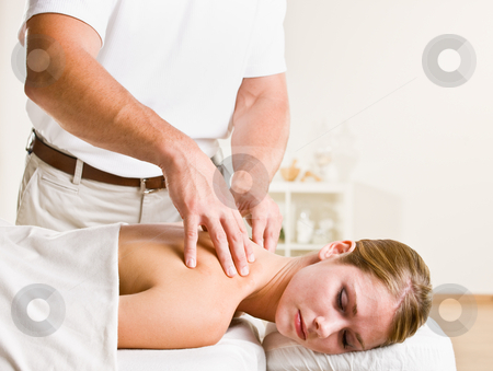 Massage therapist giving woman massage stock photo, Massage therapist giving woman massage by Jonathan Ross