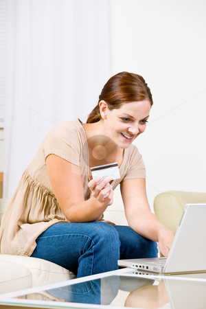 Young Woman using credit card to buy internet merchandise stock photo, Woman using creditcard to buy internet merchandise by Jonathan Ross
