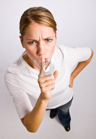 Woman making shhh gesture stock photo, Woman making shhh gesture by Jonathan Ross
