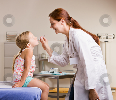 Doctor checking girl?s temperature stock photo, Doctor checking girl?s temperature by Jonathan Ross