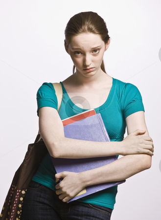 Sad student carrying book bag and notebook stock photo, Sad student carrying book bag and notebook by Jonathan Ross