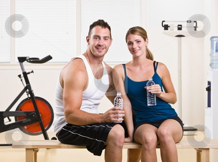 Man and woman drinking water in health club stock photo, Man and woman drinking water in health club by Jonathan Ross