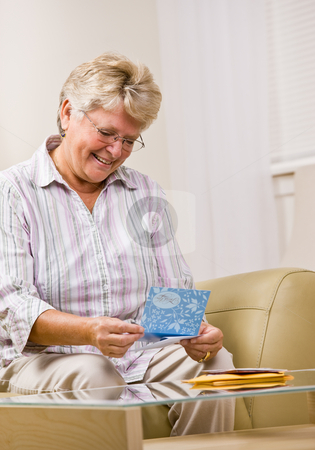 Senior woman reading note card stock photo, Senior woman reading note card by Jonathan Ross