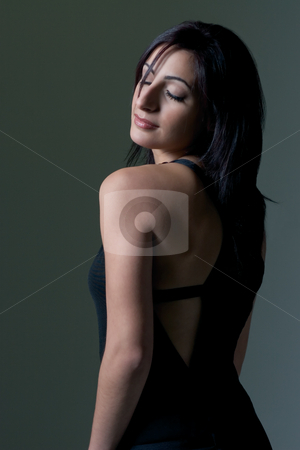 Fashion model stock photo, Twenty something fashion model looking over shoulder with eye close by Yann Poirier
