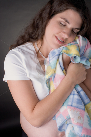 Pregnant women napping stock photo, Seven month old pregnant women napping with blanky by Yann Poirier