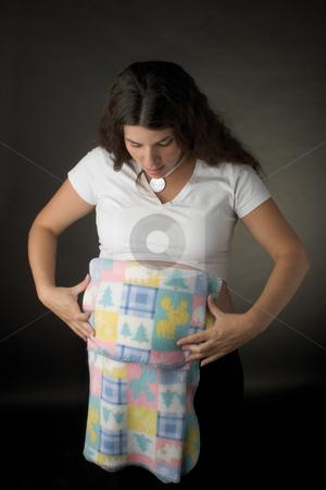 Women folding blanket stock photo,  by Yann Poirier
