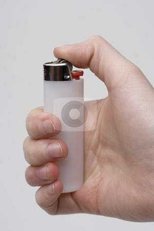 Holding lighter stock photo, Women hand holding a white lighter by Yann Poirier