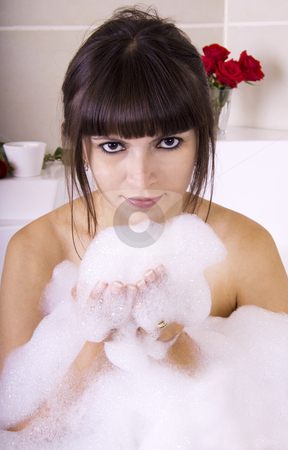 Woman in jacuzzi close-up stock photo, Woman in jacuzzi blowing the foam by Daniel Kafer