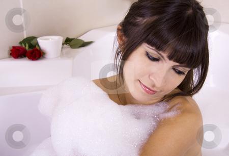 Brunette woman in jacuzzi stock photo, Romantic brunette in a jacuzzi full of foam by Daniel Kafer